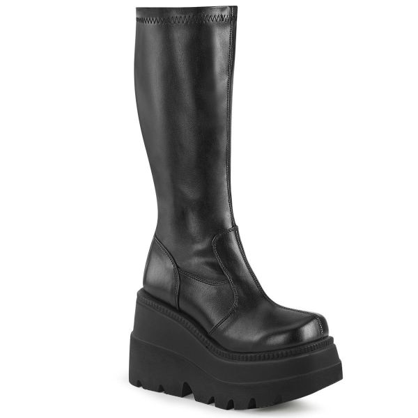 Product image of Demonia SHAKER-65 Black Stretch Vegan Faux Leather 4 1/2 inch Wedge Platform Stretch Knee High Boot Back Zip